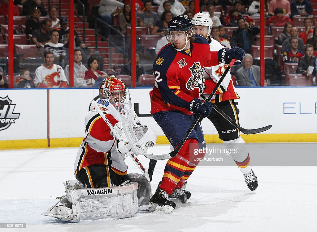 Goaltender <a gi-track='captionPersonalityLinkClicked' href=/galleries/search?phrase=Joey+MacDonald&family=editorial&specificpeople=2234367 ng-click='$event.stopPropagation()'>Joey MacDonald</a> #35 of the Calgary Flames defends the net with Jimmy Hayes #12 of the Florida Panthers in front waiting for a possible rebound at the BB&T Center on April 4, 2014 in Sunrise, Florida. The Flames defeated the Panthers 2-1.