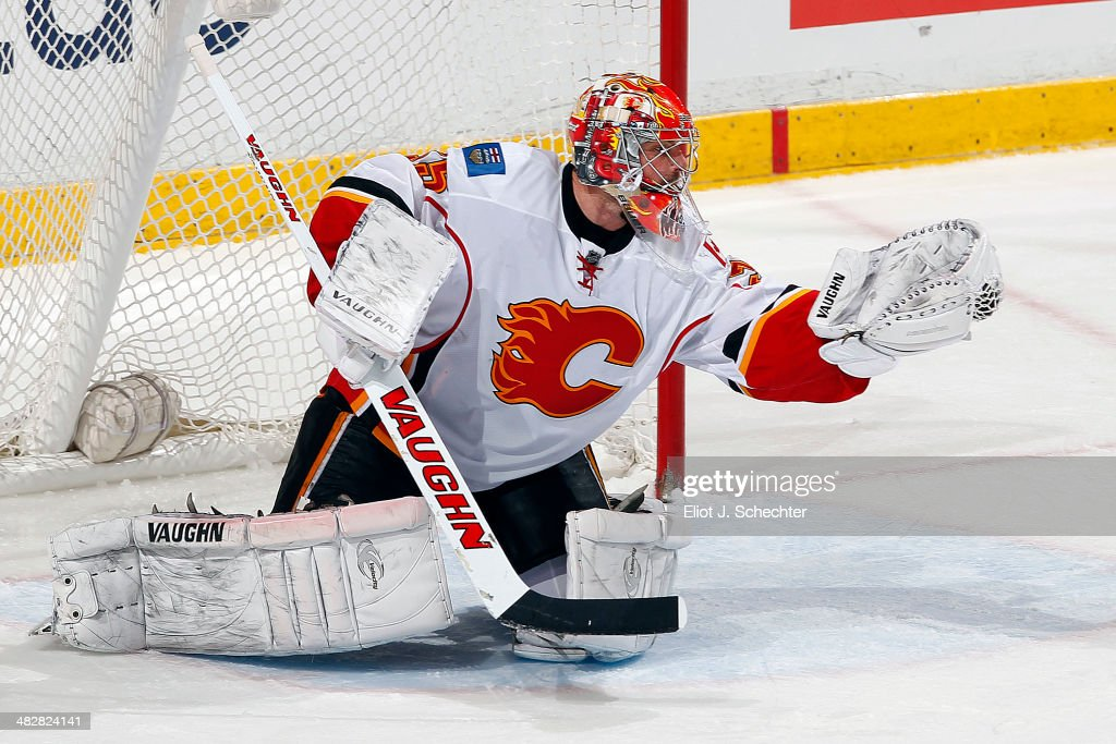 Goaltender <a gi-track='captionPersonalityLinkClicked' href=/galleries/search?phrase=Joey+MacDonald&family=editorial&specificpeople=2234367 ng-click='$event.stopPropagation()'>Joey MacDonald</a> #35 of the Calgary Flames makes a glove save against the Florida Panthers at the BB&T Center on April 4, 2014 in Sunrise, Florida.