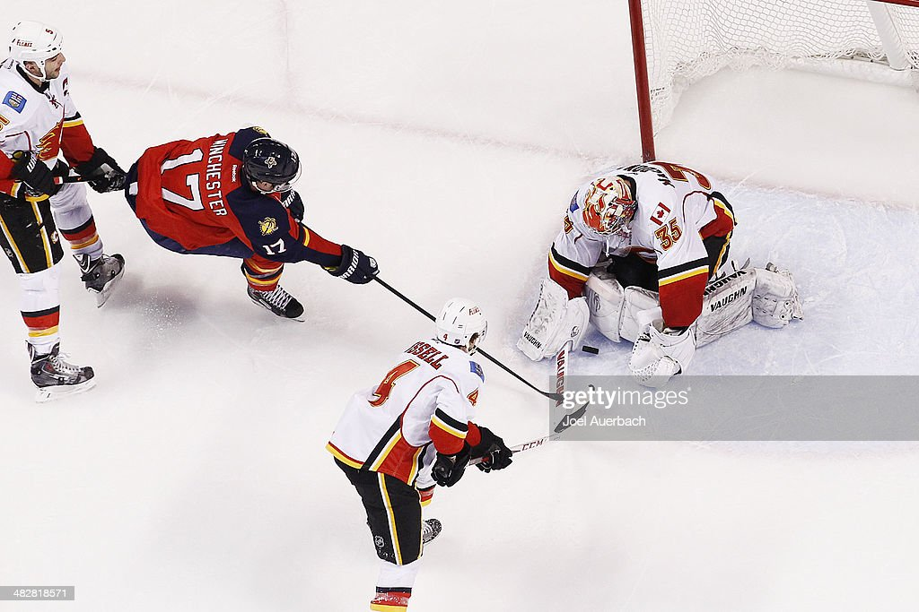 Goaltender <a gi-track='captionPersonalityLinkClicked' href=/galleries/search?phrase=Joey+MacDonald&family=editorial&specificpeople=2234367 ng-click='$event.stopPropagation()'>Joey MacDonald</a> #35 of the Calgary Flames stops a second period shot by Jesse Winchester #17 of the Florida Panthers at the BB&T Center on April 4, 2014 in Sunrise, Florida. The Flames defeated the Panthers 2-1.