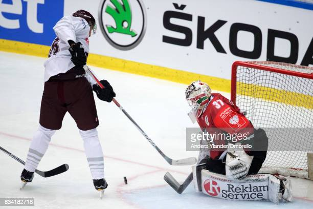 Goaltender Johan Gustafsson of the Frolunda Gothenburg makes a save against Petr Kumstat of the Sparta Prague during the Champions Hockey League...