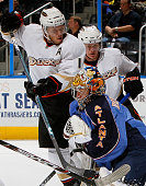 Goaltender Johan Hedberg of the Atlanta Thrashers saves a shot on goal in front of Saku Koivu of the Anaheim Ducks at Philips Arena on January 26...