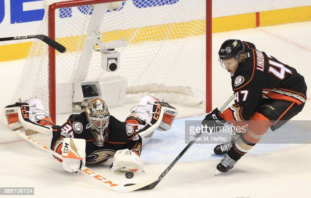Goaltender John Gibson and Hampus Lindholm of the Anaheim Ducks play the loose puck in the first period of Game Five of the Western Conference Final...