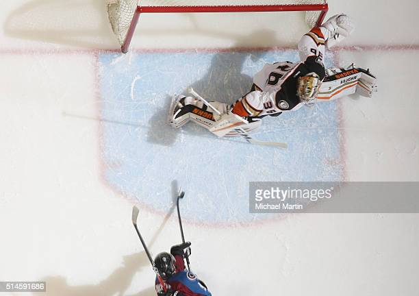 Goaltender John Gibson of the Anaheim Ducks attempts to make a save against Matt Duchene of the Colorado Avalanche at the Pepsi Center on March 9...