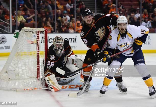 Goaltender John Gibson of the Anaheim Ducks defends his net as Sami Vatanen of the Anaheim Ducks and Calle Jarnkrok of the Nashville Predators vie or...
