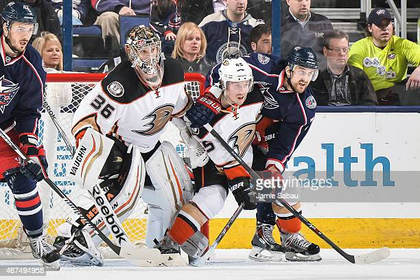 Goaltender John Gibson of the Anaheim Ducks defends the net as Sami Vatanen of the Anaheim Ducks and Nick Foligno of the Columbus Blue Jackets battle...