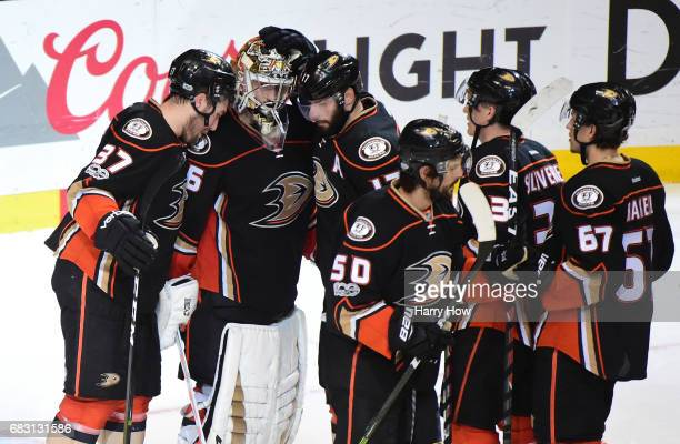 Goaltender John Gibson of the Anaheim Ducks is congratulated by teammates Nick Ritchie and Ryan Kesler after Game Two of the Western Conference Final...