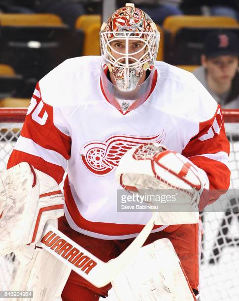 Goaltender Jonas Gustavsson of the Detroit Red Wings warms up before the game against the Boston Bruins at TD Garden on March 8 2015 in Boston...