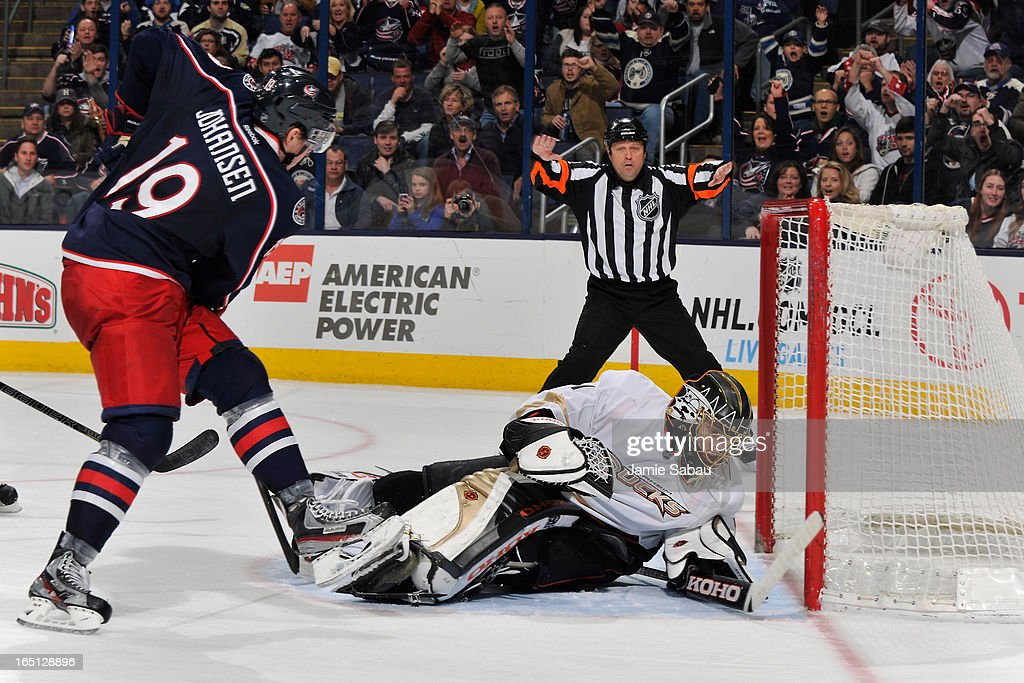 Goaltender <a gi-track='captionPersonalityLinkClicked' href=/galleries/search?phrase=Jonas+Hiller&family=editorial&specificpeople=743364 ng-click='$event.stopPropagation()'>Jonas Hiller</a> #1 of the Anaheim Ducks covers the puck during the third period against the Columbus Blue Jackets on March 31, 2013 at Nationwide Arena in Columbus, Ohio. Columbus defeated Anaheim 2-1 in overtime.