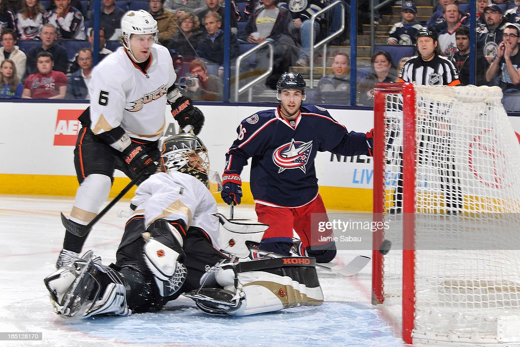Goaltender Jonas Hiller #1 of the Anaheim Ducks looks back as the puck hits off the post against the Columbus Blue Jackets during the first period on March 31, 2013 at Nationwide Arena in Columbus, Ohio.