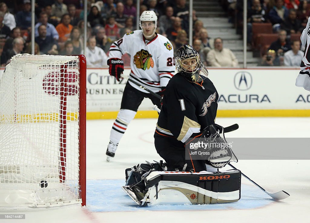 Goaltender Jonas Hiller #1 of the Anaheim Ducks looks back at the puck in the net after Nick Leddy #8 of the Chicago Blackhawks scored in the second period at Honda Center on March 20, 2013 in Anaheim, California.