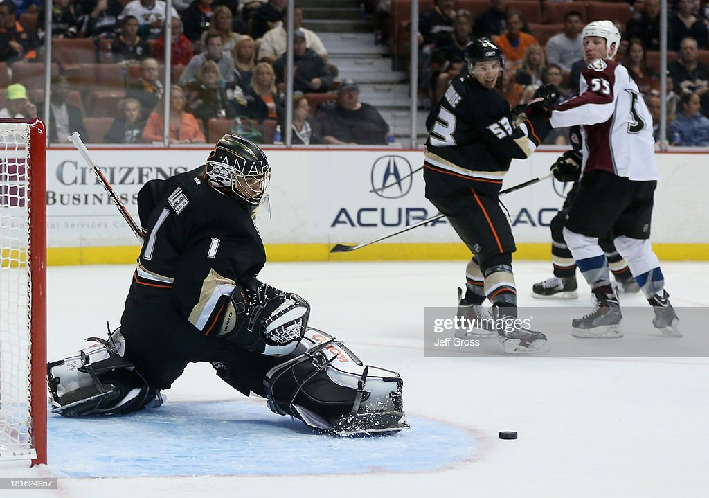 Goaltender <a gi-track='captionPersonalityLinkClicked' href=/galleries/search?phrase=Jonas+Hiller&family=editorial&specificpeople=743364 ng-click='$event.stopPropagation()'>Jonas Hiller</a> #1 of the Anaheim Ducks makes a kick save against the Colorado Avalanche in the second period at Honda Center on September 22, 2013 in Anaheim, California. The Avalanche defeated the Ducks 2-1.