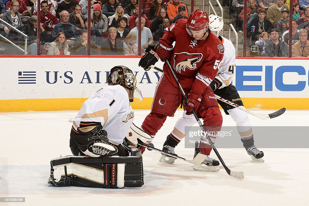 Goaltender <a gi-track='captionPersonalityLinkClicked' href=/galleries/search?phrase=Jonas+Hiller&family=editorial&specificpeople=743364 ng-click='$event.stopPropagation()'>Jonas Hiller</a> #1 of the Anaheim Ducks makes a stick save on the shot by <a gi-track='captionPersonalityLinkClicked' href=/galleries/search?phrase=Antoine+Vermette&family=editorial&specificpeople=206302 ng-click='$event.stopPropagation()'>Antoine Vermette</a> #50 of the Phoenix Coyotes as Anaheim's <a gi-track='captionPersonalityLinkClicked' href=/galleries/search?phrase=Hampus+Lindholm&family=editorial&specificpeople=8630299 ng-click='$event.stopPropagation()'>Hampus Lindholm</a> #47 defends during the second period at Jobing.com Arena on November 23, 2013 in Glendale, Arizona.