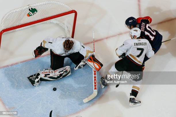 Goaltender Jonas Hiller of the Anaheim Ducks stops a shot by David Booth of the Florida Panthers on February 1 2010 at the BankAtlantic Center in...