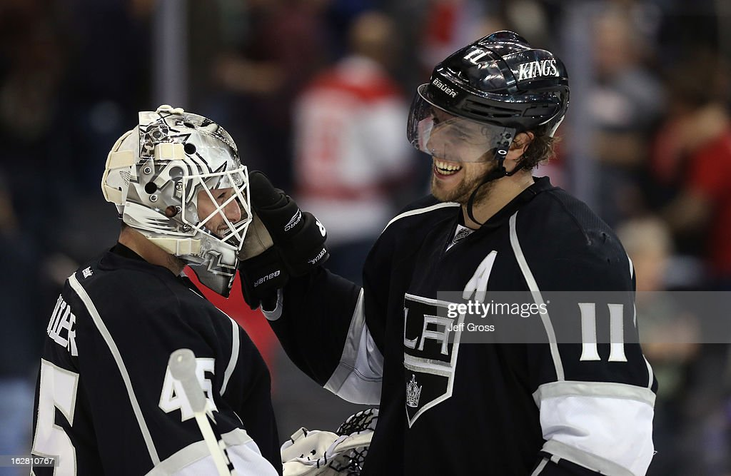 Goaltender <a gi-track='captionPersonalityLinkClicked' href=/galleries/search?phrase=Jonathan+Bernier&family=editorial&specificpeople=540491 ng-click='$event.stopPropagation()'>Jonathan Bernier</a> #45 and <a gi-track='captionPersonalityLinkClicked' href=/galleries/search?phrase=Anze+Kopitar&family=editorial&specificpeople=634911 ng-click='$event.stopPropagation()'>Anze Kopitar</a> #11 of the Los Angeles Kings congratulate one another following their teams 2-1 victory over the Detroit Red Wings at Staples Center on February 27, 2013 in Los Angeles, California.