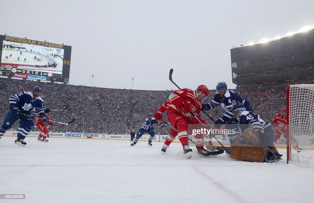 Goaltender Jonathan Bernier and Cody Franson of the Toronto Maple Leafs defend the play to the net of Gustav Nyquist of the Detroit Red Wings in the...