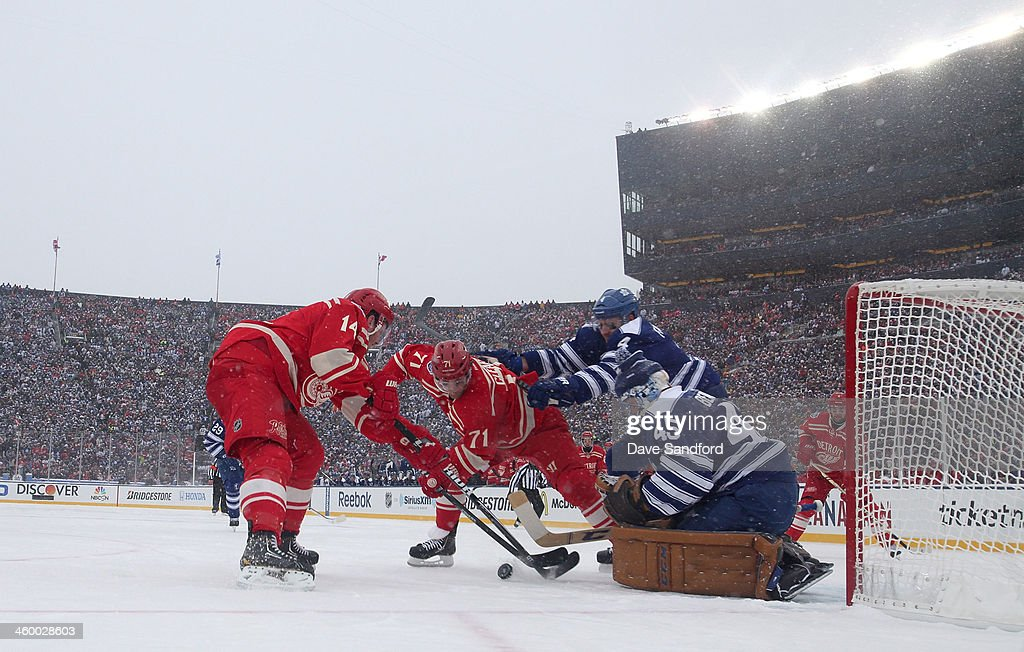 Goaltender Jonathan Bernier and Cody Franson of the Toronto Maple Leafs defend the play at the net of Gustav Nyquist and Daniel Cleary of the Detroit...