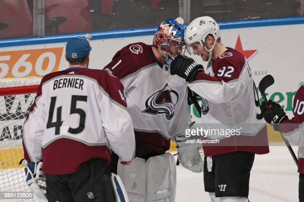 Goaltender Jonathan Bernier and Gabriel Landeskog congratulate goaltender Semyon Varlamov of the Colorado Avalanche after the game against the...