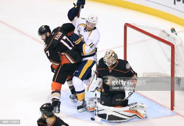 Goaltender Jonathan Bernier of the Anaheim Ducks makes a save as Ryan Kesler of the Anaheim Ducks and Colton Sissons of the Nashville Predators vie...