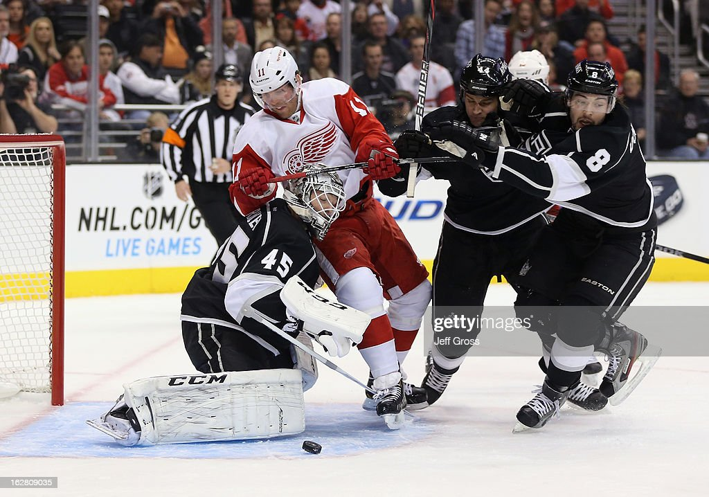 Goaltender Jonathan Bernier #45 of the Los Angeles Kings makes a save, as Daniel Cleary #11 of the Detroit Red Wings, Davis Drewiske #44 and Drew Doughty #8 of the Los Angeles Kings pursue in the first period at Staples Center on February 27, 2013 in Los Angeles, California.