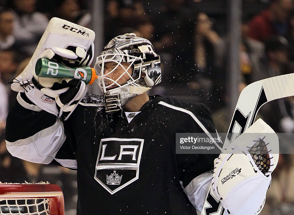 Goaltender Jonathan Bernier #45 of the Los Angeles Kings squirts water on his face prior to the NHL game against the Columbus Blue Jackets at Staples Center on February 15, 2013 in Los Angeles, California. The Kings defeated the Blue Jackets 2-1.