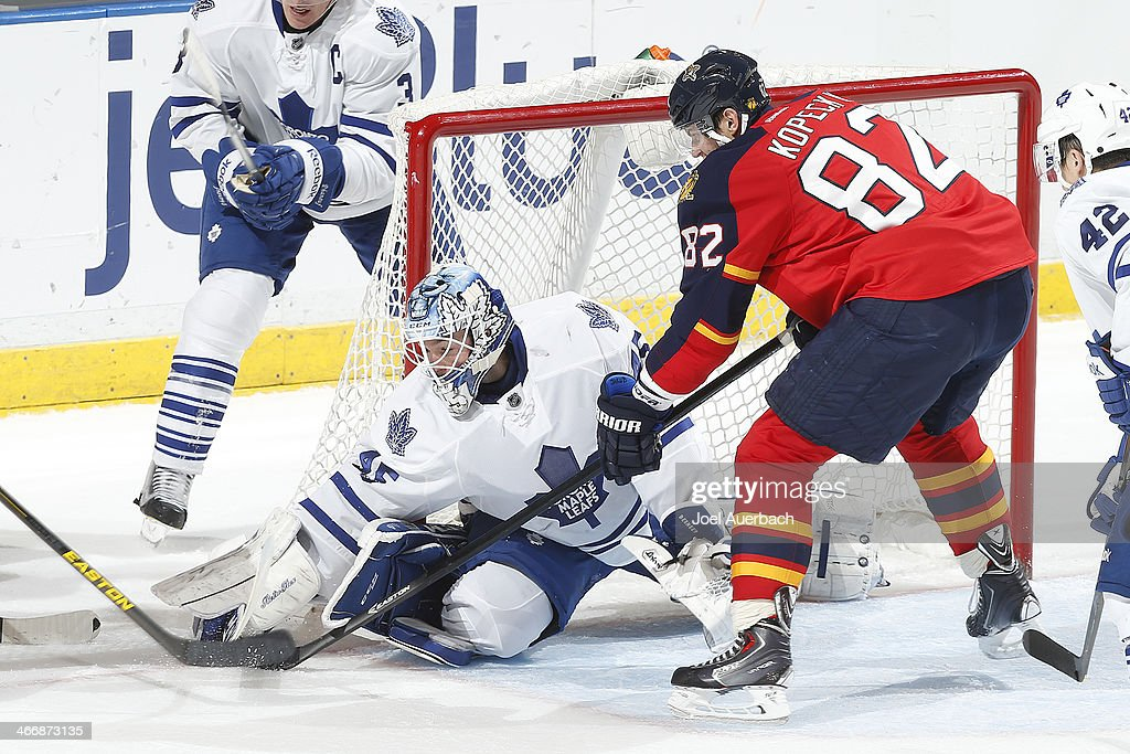 Goaltender <a gi-track='captionPersonalityLinkClicked' href=/galleries/search?phrase=Jonathan+Bernier&family=editorial&specificpeople=540491 ng-click='$event.stopPropagation()'>Jonathan Bernier</a> #45 of the Toronto Maple Leafs defends the net against <a gi-track='captionPersonalityLinkClicked' href=/galleries/search?phrase=Tomas+Kopecky&family=editorial&specificpeople=2234349 ng-click='$event.stopPropagation()'>Tomas Kopecky</a> #82 of the Florida Panthers at the BB&T Center on February 4, 2014 in Sunrise, Florida. The Panthers defeated the Maple Leafs 4-1.