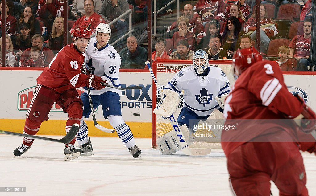 Goaltender <a gi-track='captionPersonalityLinkClicked' href=/galleries/search?phrase=Jonathan+Bernier&family=editorial&specificpeople=540491 ng-click='$event.stopPropagation()'>Jonathan Bernier</a> #45 of the Toronto Maple Leafs looks to make a save on the shot by Keith Yandle #3 of the Phoenix Coyotes as <a gi-track='captionPersonalityLinkClicked' href=/galleries/search?phrase=Shane+Doan&family=editorial&specificpeople=201614 ng-click='$event.stopPropagation()'>Shane Doan</a> #19 of the Coyotes and <a gi-track='captionPersonalityLinkClicked' href=/galleries/search?phrase=Carl+Gunnarsson&family=editorial&specificpeople=5557315 ng-click='$event.stopPropagation()'>Carl Gunnarsson</a> #36 of the Leafs battle in front of the net at Jobing.com Arena on January 20, 2014 in Glendale, Arizona.
