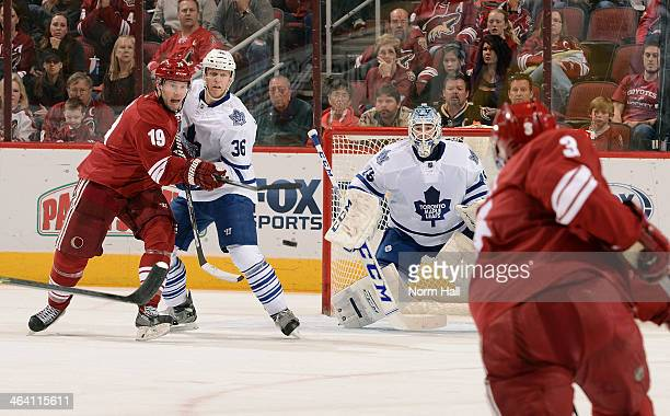 Goaltender Jonathan Bernier of the Toronto Maple Leafs looks to make a save on the shot by Keith Yandle of the Phoenix Coyotes as Shane Doan of the...