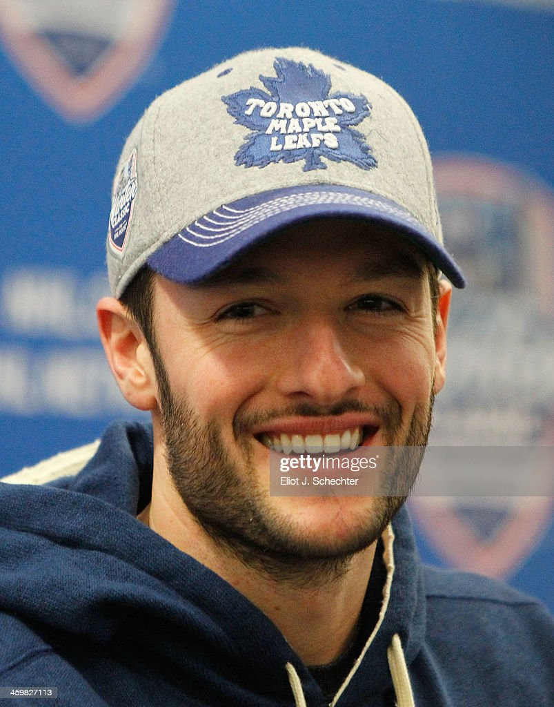 Goaltender <a gi-track='captionPersonalityLinkClicked' href=/galleries/search?phrase=Jonathan+Bernier&family=editorial&specificpeople=540491 ng-click='$event.stopPropagation()'>Jonathan Bernier</a> #45 of the Toronto Maple Leafs speaks at a press conference after the 2014 Bridgestone NHL Winter Classic team practice session on December 31, 2013 at Michigan Stadium in Ann Arbor, Michigan.