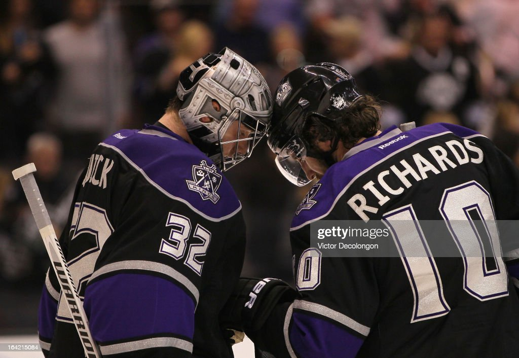 Goaltender <a gi-track='captionPersonalityLinkClicked' href=/galleries/search?phrase=Jonathan+Quick&family=editorial&specificpeople=2271852 ng-click='$event.stopPropagation()'>Jonathan Quick</a> #32 and Mike Richards #10 of the Los Angeles Kings celebrate their 4-0 win against the Phoenix Coyotes in the NHL game at Staples Center on March 18, 2013 in Los Angeles, California. The Kings defeated the Coyotes 4-0.
