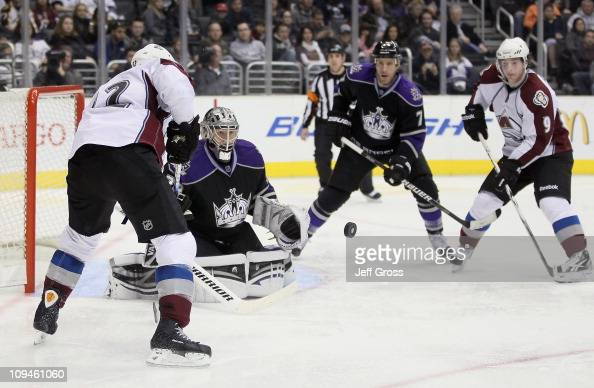 Goaltender Jonathan Quick of Los Angeles Kings makes a save on a shot by Kevin Porter of the Colorado Avalanche as Rob Scuderi of the Kings and Matt...