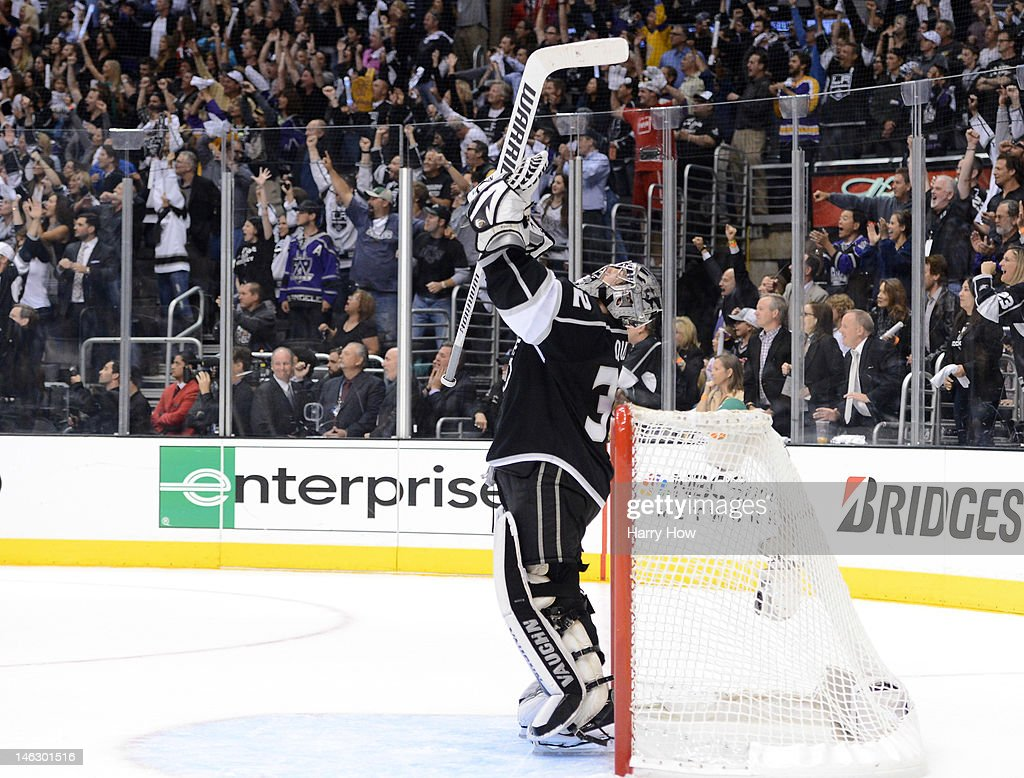 Goaltender Jonathan Quick of the Los Angeles Kings celebrates just prior to the end of the third period against the New Jersey Devils in Game Six of...