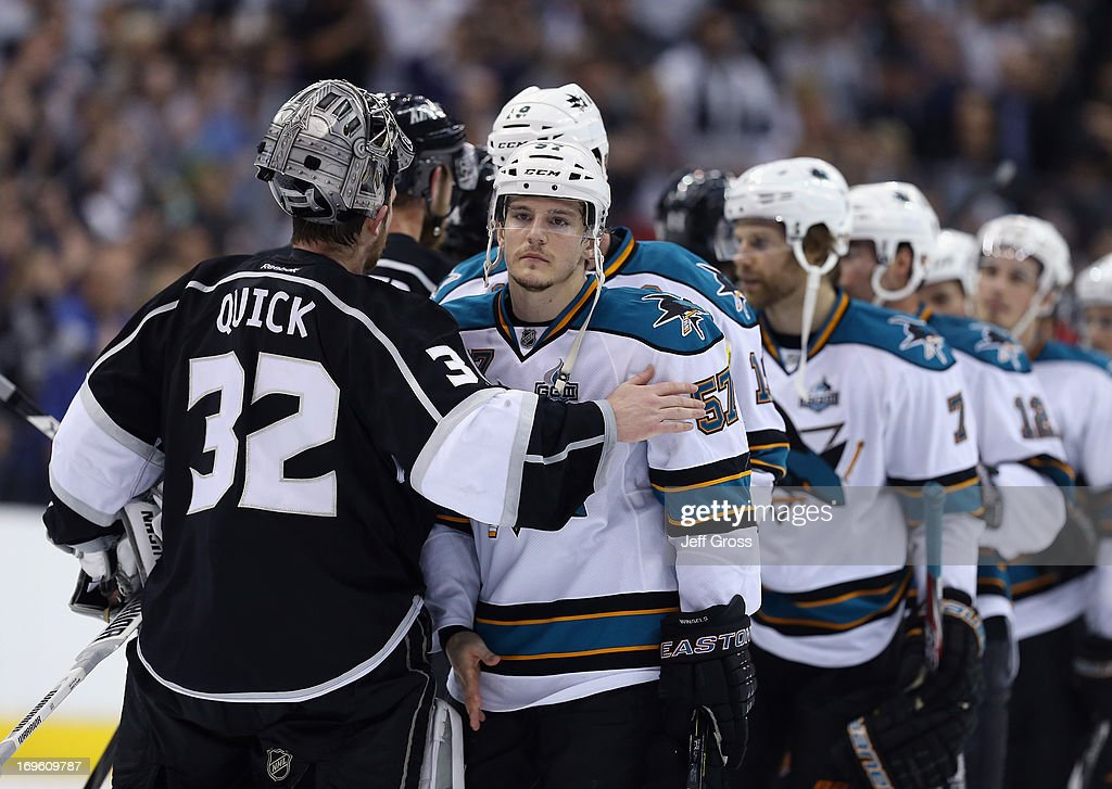 Goaltender <a gi-track='captionPersonalityLinkClicked' href=/galleries/search?phrase=Jonathan+Quick&family=editorial&specificpeople=2271852 ng-click='$event.stopPropagation()'>Jonathan Quick</a> #32 of the Los Angeles Kings consoles <a gi-track='captionPersonalityLinkClicked' href=/galleries/search?phrase=Tommy+Wingels&family=editorial&specificpeople=5807738 ng-click='$event.stopPropagation()'>Tommy Wingels</a> #57 of the San Jose Sharks at the conclussion of Game Seven of the Western Conference Semifinals during the 2013 NHL Stanley Cup Playoffs at Staples Center on May 28, 2013 in Los Angeles, California. The Kings defeated the Sharks 2-1.