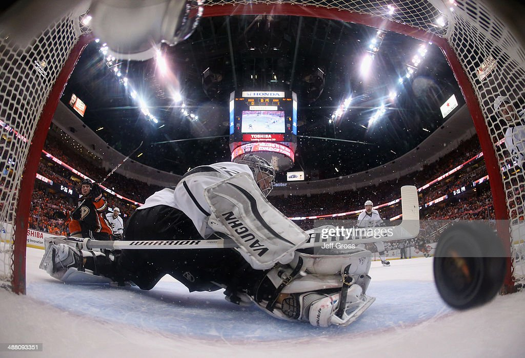Goaltender Jonathan Quick of the Los Angeles Kings gives up a goal by Matt Beleskey of the Anaheim Ducks in the first period of Game One of the...