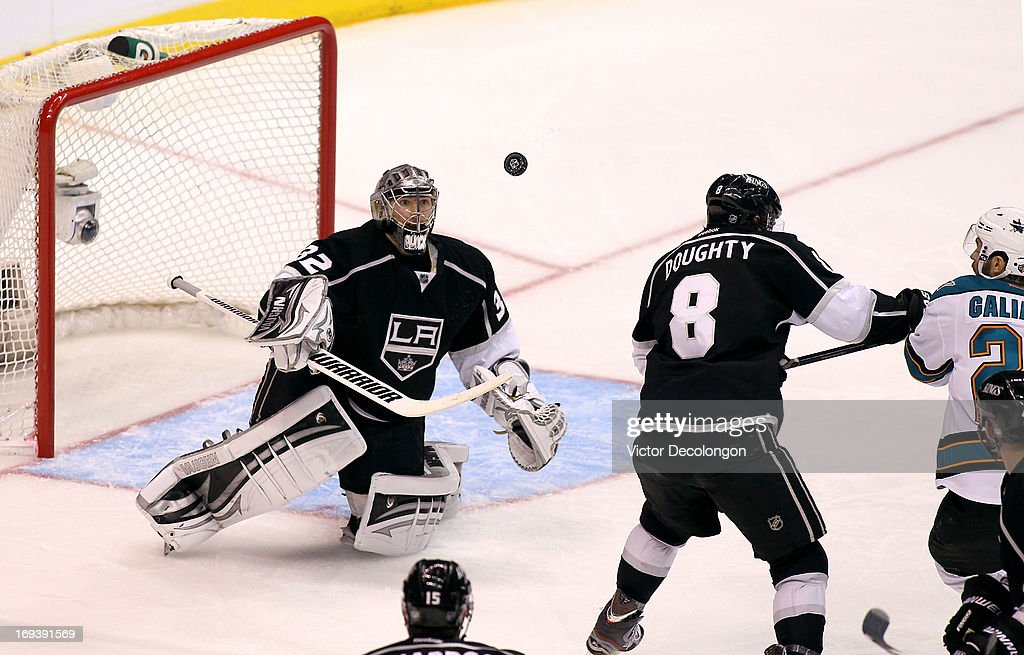 Goaltender <a gi-track='captionPersonalityLinkClicked' href=/galleries/search?phrase=Jonathan+Quick&family=editorial&specificpeople=2271852 ng-click='$event.stopPropagation()'>Jonathan Quick</a> #32 of the Los Angeles Kings looks to control the puck after deflecting off his stick in the second period of Game Five of the Western Conference Semifinals against the San Jose Sharks during the 2013 NHL Stanley Cup Playoffs at Staples Center on May 23, 2013 in Los Angeles, California. The Kings defeated the Sharks 3-0.