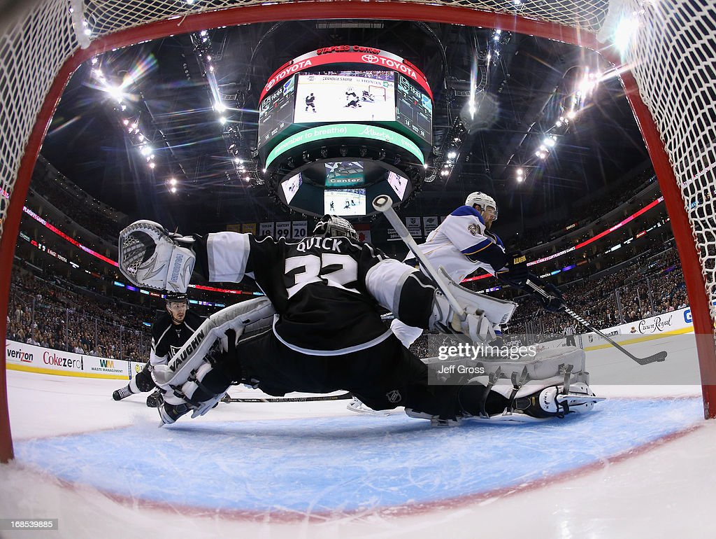 Goaltender Jonathan Quick #32 of the Los Angeles Kings lunges toward Patrik Berglund #21 of the St. Louis Blues in the third period of Game Six of the Western Conference Quarterfinals during the 2013 NHL Stanley Cup Playoffs at Staples Center on May 10, 2013 in Los Angeles, California. The Kings defeated the Blues 2-1.