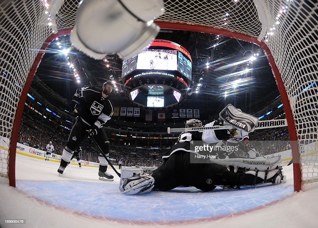 Goaltender <a gi-track='captionPersonalityLinkClicked' href=/galleries/search?phrase=Jonathan+Quick&family=editorial&specificpeople=2271852 ng-click='$event.stopPropagation()'>Jonathan Quick</a> #32 of the Los Angeles Kings makes a blocker save on a shot by <a gi-track='captionPersonalityLinkClicked' href=/galleries/search?phrase=Bryan+Bickell&family=editorial&specificpeople=241498 ng-click='$event.stopPropagation()'>Bryan Bickell</a> #29 of the Chicago Blackhawks from the low slot area late in the third period of Game Three of the Western Conference Final during the 2013 NHL Stanley Cup Playoffs at Staples Center on June 4, 2013 in Los Angeles, California. The Kings defeated the Blackhawks 3-1.