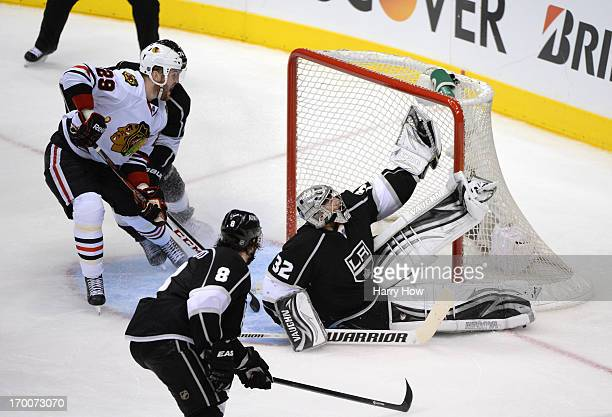 Goaltender Jonathan Quick of the Los Angeles Kings makes a glove save on a shot by Patrick Kane of the Chicago Blackhawks from the right wing in the...