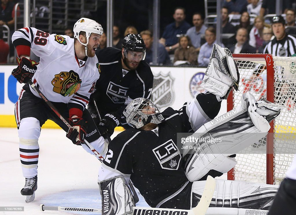 Goaltender <a gi-track='captionPersonalityLinkClicked' href=/galleries/search?phrase=Jonathan+Quick&family=editorial&specificpeople=2271852 ng-click='$event.stopPropagation()'>Jonathan Quick</a> #32 of the Los Angeles Kings makes a glove save on a shot by Patrick Kane #88 of the Chicago Blackhawks (not in photo) from the right wing as <a gi-track='captionPersonalityLinkClicked' href=/galleries/search?phrase=Bryan+Bickell&family=editorial&specificpeople=241498 ng-click='$event.stopPropagation()'>Bryan Bickell</a> #29 of the Chicago Blackhawks and <a gi-track='captionPersonalityLinkClicked' href=/galleries/search?phrase=Dwight+King+-+Ice+Hockey+Player&family=editorial&specificpeople=4537297 ng-click='$event.stopPropagation()'>Dwight King</a> #74 of the Los Angeles Kings vie for position near the crease area in the third period of Game Four of the Western Conference Final during the 2013 NHL Stanley Cup Playoffs at Staples Center on June 6, 2013 in Los Angeles, California. The Blackhawks defeated the Kings 3-2.