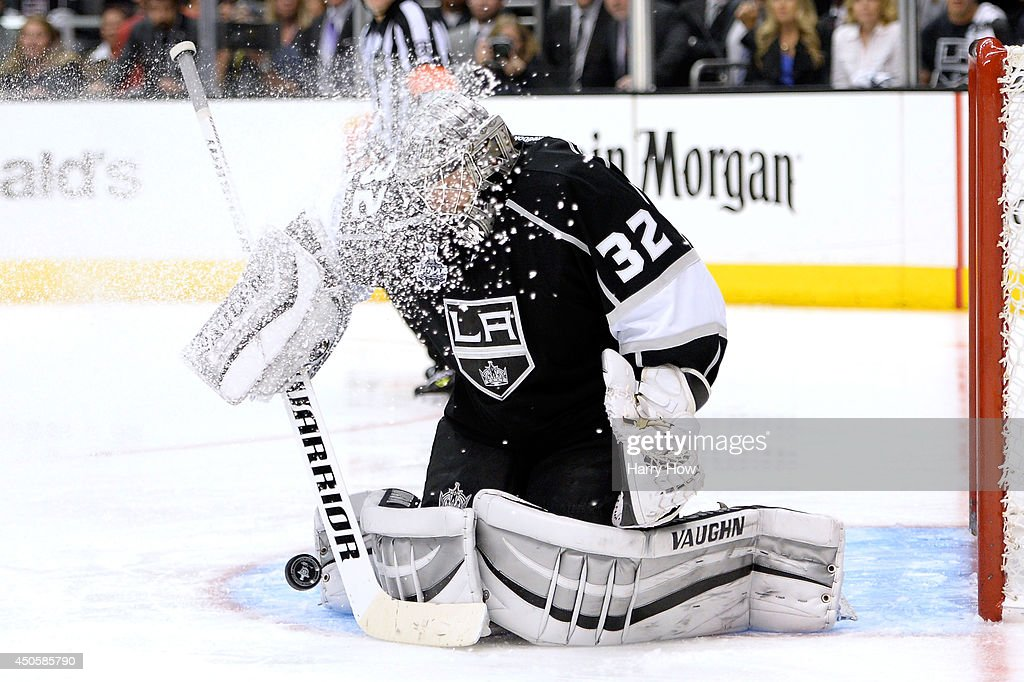 Goaltender Jonathan Quick of the Los Angeles Kings makes a save as ice flies into his mask in double overtime against the New York Rangers during...