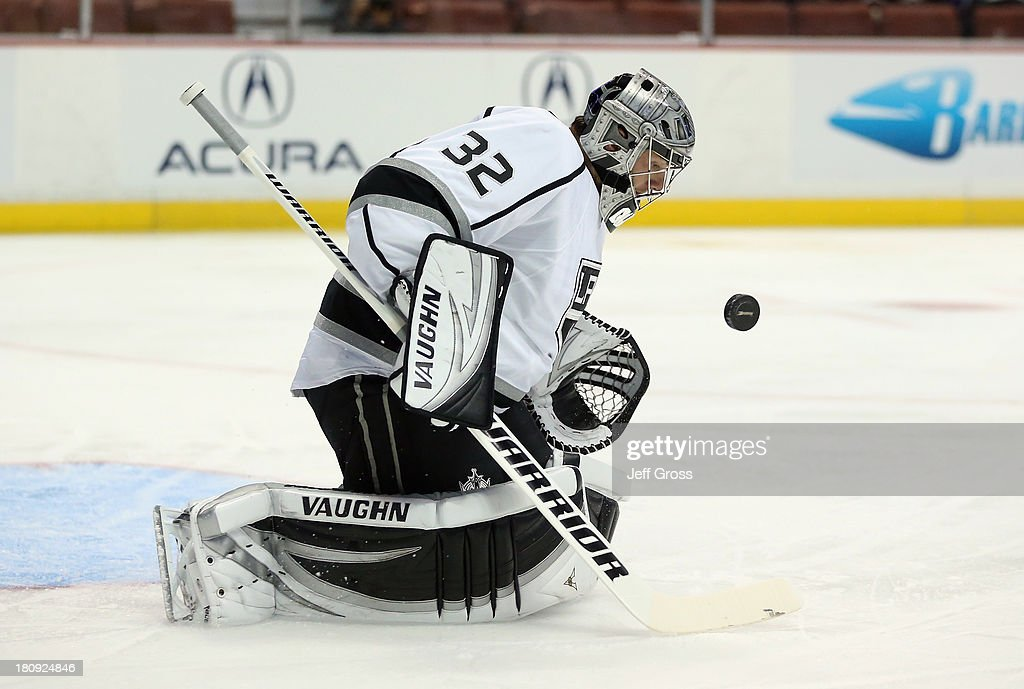 Goaltender <a gi-track='captionPersonalityLinkClicked' href=/galleries/search?phrase=Jonathan+Quick&family=editorial&specificpeople=2271852 ng-click='$event.stopPropagation()'>Jonathan Quick</a> #32 of the Los Angeles Kings makes a save in the first period against the Anaheim Ducks at Honda Center on September 17, 2013 in Anaheim, California. The Kings defeated the Ducks 6-0.