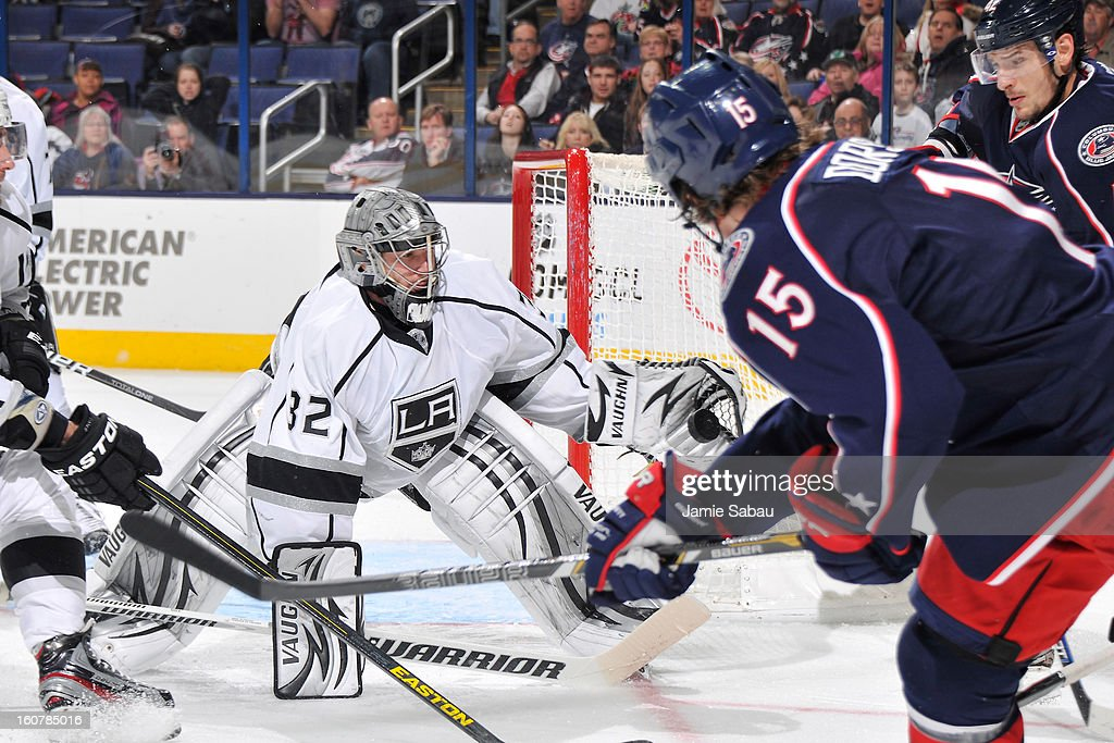 Goaltender <a gi-track='captionPersonalityLinkClicked' href=/galleries/search?phrase=Jonathan+Quick&family=editorial&specificpeople=2271852 ng-click='$event.stopPropagation()'>Jonathan Quick</a> #32 of the Los Angeles Kings makes a save on a shot from <a gi-track='captionPersonalityLinkClicked' href=/galleries/search?phrase=Derek+Dorsett&family=editorial&specificpeople=4306277 ng-click='$event.stopPropagation()'>Derek Dorsett</a> #15 of the Columbus Blue Jackets in the third period on February 5, 2013 at Nationwide Arena in Columbus, Ohio. Los Angeles defeated Columbus 4-2.