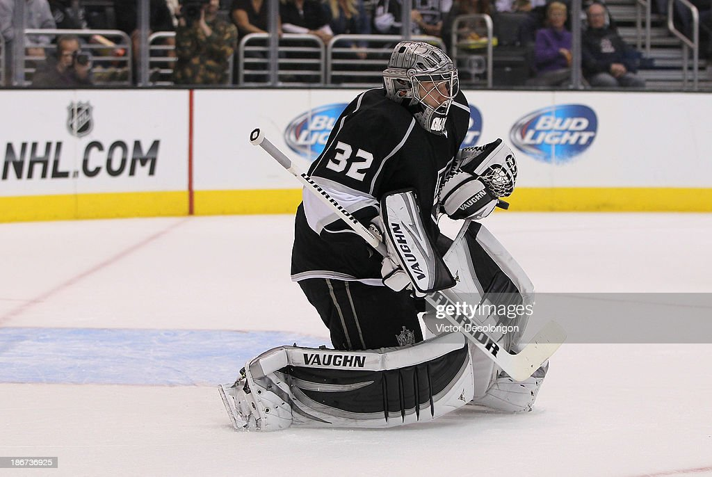 Goaltender <a gi-track='captionPersonalityLinkClicked' href=/galleries/search?phrase=Jonathan+Quick&family=editorial&specificpeople=2271852 ng-click='$event.stopPropagation()'>Jonathan Quick</a> #32 of the Los Angeles Kings makes a save during the NHL game against the Nashville Predators at Staples Center on November 2, 2013 in Los Angeles, California. The Predators defeated the Kings 4-3.