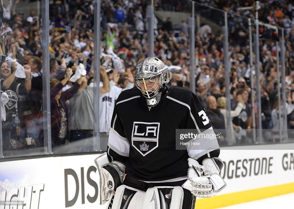 Goaltender <a gi-track='captionPersonalityLinkClicked' href=/galleries/search?phrase=Jonathan+Quick&family=editorial&specificpeople=2271852 ng-click='$event.stopPropagation()'>Jonathan Quick</a> #32 of the Los Angeles Kings reacts after a goal by teammate Dwight King #74 of the Los Angeles Kings (not in photo) in the third period of Game Three of the Western Conference Final against the Chicago Blackhawks during the 2013 NHL Stanley Cup Playoffs at Staples Center on June 4, 2013 in Los Angeles, California. The Kings defeated the Blackawks 3-1.