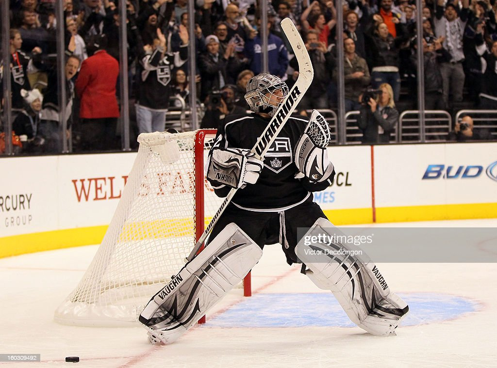 Goaltender <a gi-track='captionPersonalityLinkClicked' href=/galleries/search?phrase=Jonathan+Quick&family=editorial&specificpeople=2271852 ng-click='$event.stopPropagation()'>Jonathan Quick</a> #32 of the Los Angeles Kings reacts after making the last save in shootout overtime to clinch the win against the Vancouver Canucks at Staples Center on January 28, 2013 in Los Angeles, California. The Kings defeated the Canucks 3-2 in shootout overtime. The Kings defeated the Canucks 3-2 in shootout overtime.
