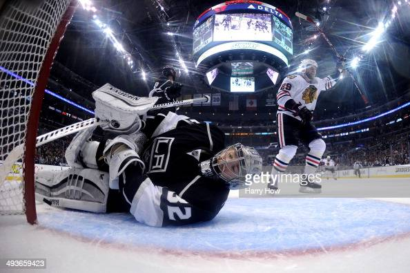 Goaltender Jonathan Quick of the Los Angeles Kings reacts after allowing the first goal of the game to Jonathan Toews as teammate Bryan Bickell of...