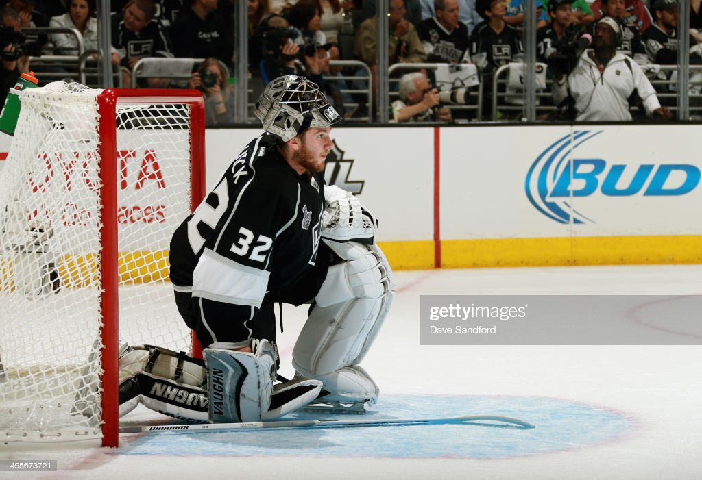Goaltender Jonathan Quick of the Los Angeles Kings reacts during the first period of Game One of the 2014 Stanley Cup Final against the New York...