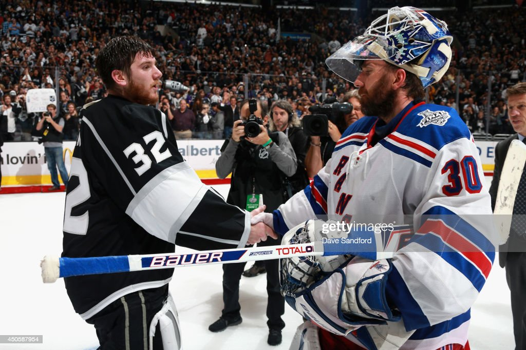 Goaltender <a gi-track='captionPersonalityLinkClicked' href=/galleries/search?phrase=Jonathan+Quick&family=editorial&specificpeople=2271852 ng-click='$event.stopPropagation()'>Jonathan Quick</a> #32 of the Los Angeles Kings shakes hands with goaltender <a gi-track='captionPersonalityLinkClicked' href=/galleries/search?phrase=Henrik+Lundqvist&family=editorial&specificpeople=217958 ng-click='$event.stopPropagation()'>Henrik Lundqvist</a> #30 of the New York Rangers after the Kings defeated the Rangers 3-2 in double overtime of Game Five of the 2014 Stanley Cup Final at the Staples Center on June 13, 2014 in Los Angeles, California. The Kings won the game 3-2 and win the series 4-1.