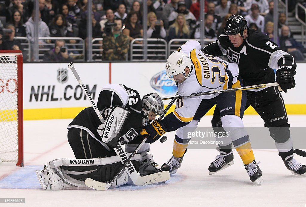Goaltender <a gi-track='captionPersonalityLinkClicked' href=/galleries/search?phrase=Jonathan+Quick&family=editorial&specificpeople=2271852 ng-click='$event.stopPropagation()'>Jonathan Quick</a> #32 of the Los Angeles Kings tries to cover the puck as defenseman <a gi-track='captionPersonalityLinkClicked' href=/galleries/search?phrase=Matt+Greene&family=editorial&specificpeople=536126 ng-click='$event.stopPropagation()'>Matt Greene</a> #2 of the Los Angeles Kings defends <a gi-track='captionPersonalityLinkClicked' href=/galleries/search?phrase=Paul+Gaustad&family=editorial&specificpeople=577980 ng-click='$event.stopPropagation()'>Paul Gaustad</a> #28 of the Nashville Predators at the edge of the crease area in the third period during the NHL game at Staples Center on November 2, 2013 in Los Angeles, California.