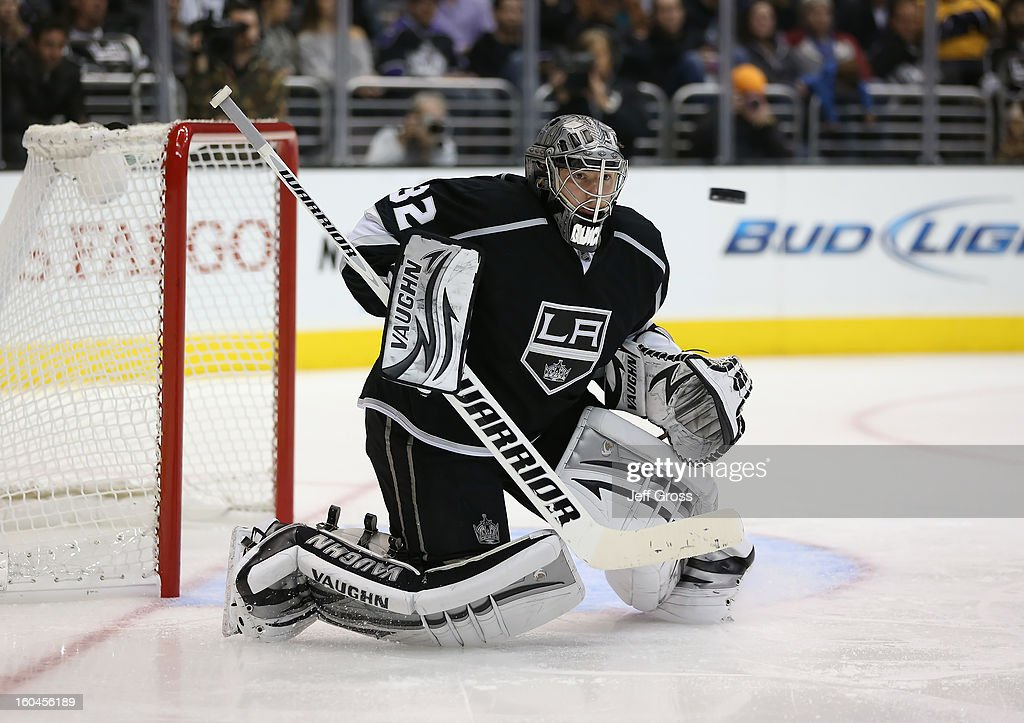 Goaltender Jonathan Quick #32 of the Los Angeles Kings watches the puck against the Nashville Predators in the third period at Staples Center on January 31, 2013 in Los Angeles, California. The Predators defeated the Kings 2-1 in a shootout.