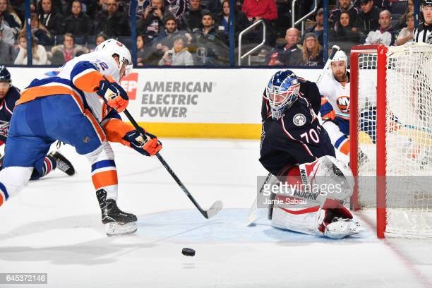 Goaltender Joonas Korpisalo of the Columbus Blue Jackets blocks a shot by Josh Bailey of the New York Islanders during the second period of a game on...